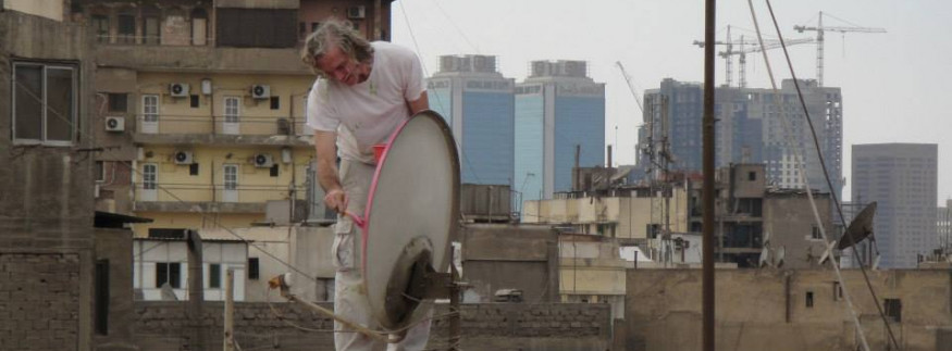 Learn About the Artist Behind the Initiative to Colour Satellite Dishes on Cairo Roofs